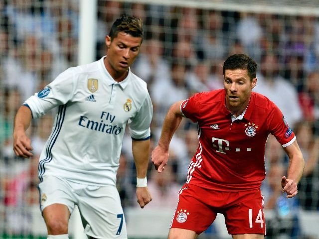 Cristiano Ronaldo [in white] trying to deceive Xabi Alonso