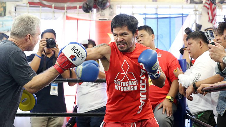 Manny Pacquio spares with long time trainer Freddie Roach