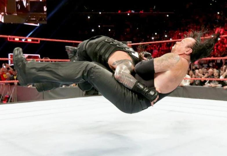 Roman Reigns spears the dreaded Undertaker to the floor at Wrestlemania 33