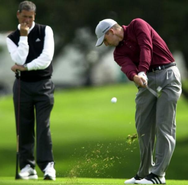 Sergio Garcia clubs the ball as his father watches on