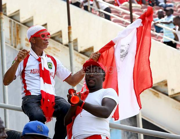 Two supporters of Asante Kotoko enjoying the 2016-17 Ghana Premier League match between Hearts of Oak vs Kotoko at the Accra Sports Stadium - PHOTO by Images Image