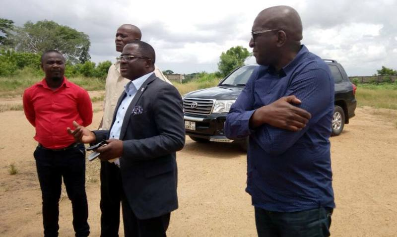 Ben Nunoo Mensah [2nd from right] leads Mr. Alassanne Diack to the proposed site for the ANOCA project in Ghana