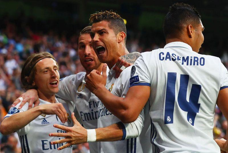 Cristiano Ronaldo celebrates with his teammates