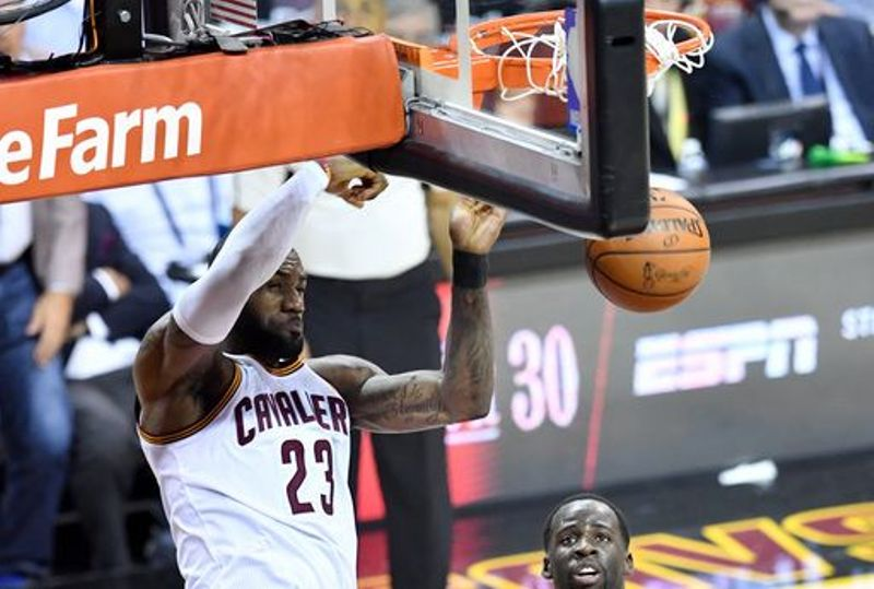 LeBron James jumps to dunk the ball