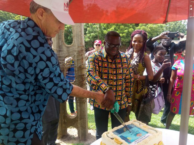Mr. Ben Nunoo Mensah [President of the Ghana Olympic Committee] being joined by Ambassador Barnes to cutting the cake