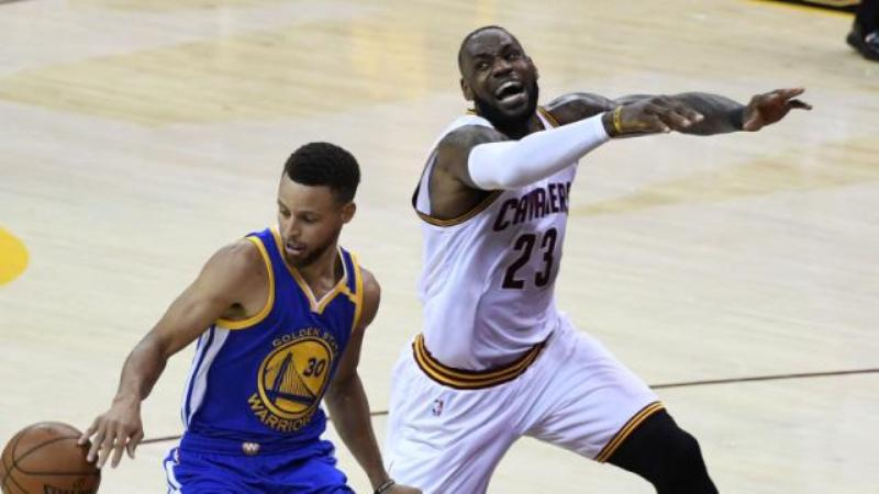 Steph Curry steals the ball away from LeBron