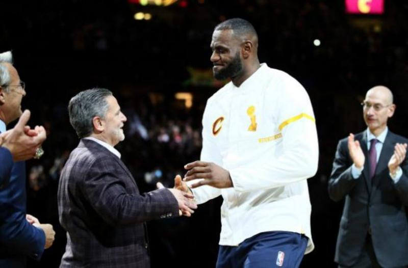 Dan Gilbert [Cavs owner] shakes hands with LeBron