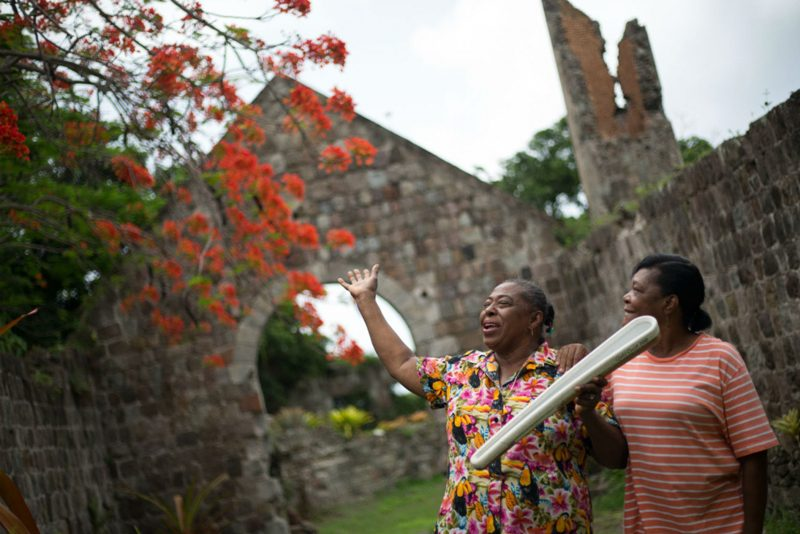 Local women with the Queen's Baton