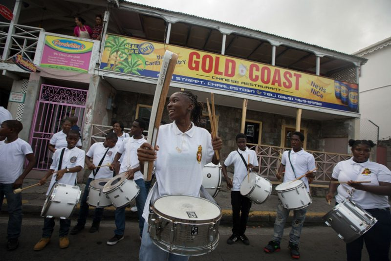 The 1st Nevis Boys Brigade drummers outside the 'Gold Coast' named restaurant