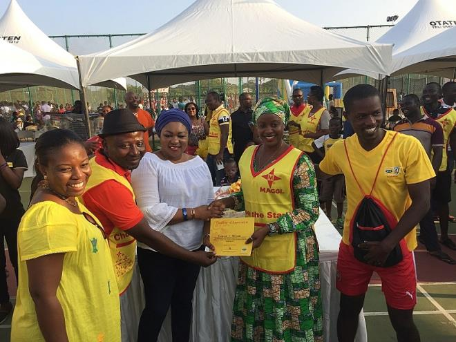 Ama Benneh-Amponsah [First from left] joins the presentation of award to the cooking contest
