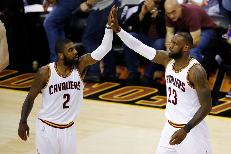 Kyrie Irving shakes off with LeBron James