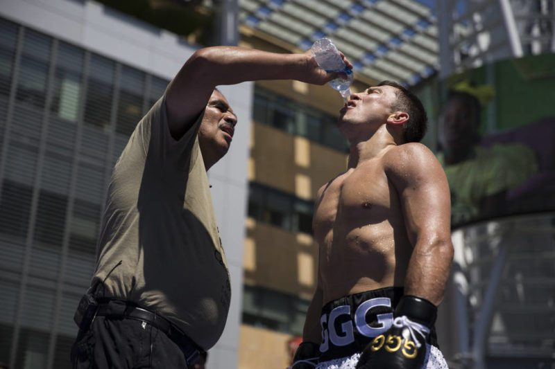 Abel Sanchez [trainer] gives Golovkin water to quench his thirst