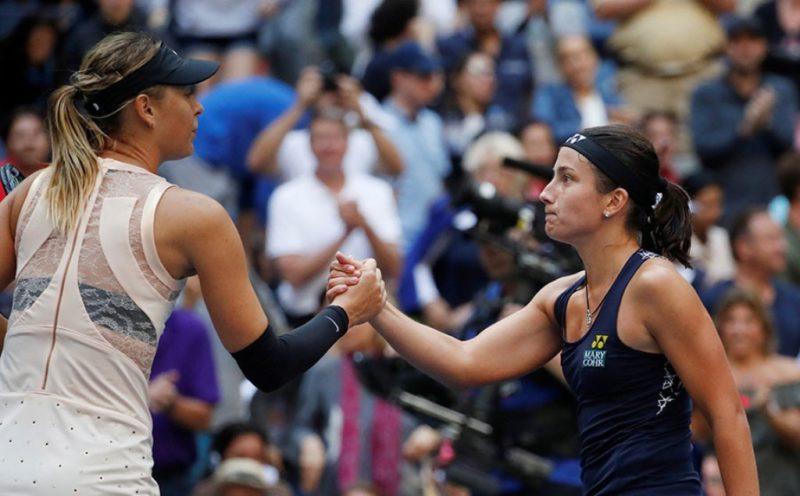 Maria Sharapova shakes hands with Sevastova