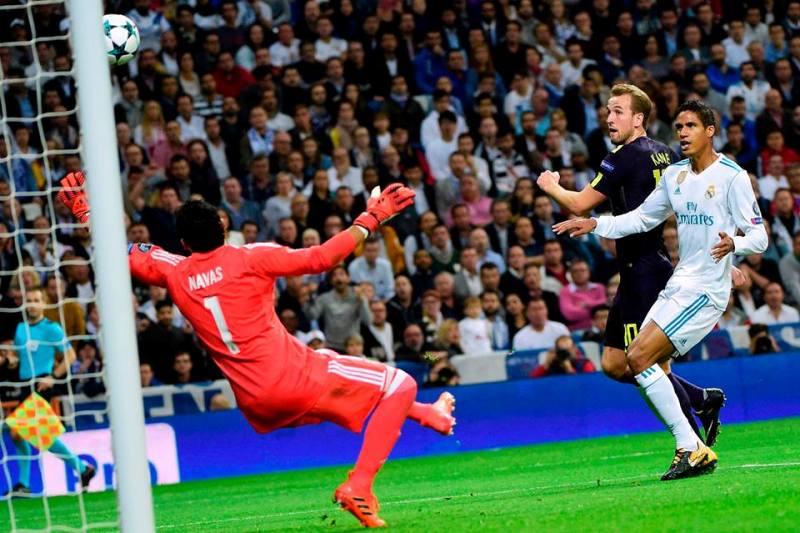 Kane putting Raphael Varane into check