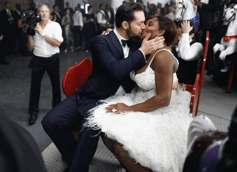 Alexis Ohanian planting a kiss of forever love into Serena Williams