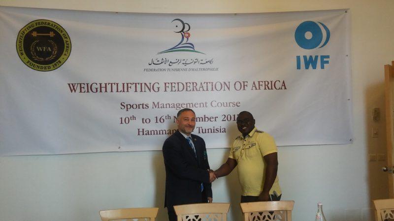 Ghana's Ken Odeng Adade [right] exchanging pleasantries with Professor Milan Mihajlovic