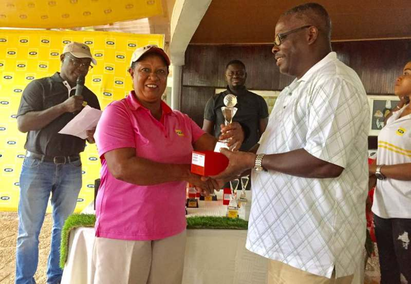 Mrs. Mona Myles Lamptey taking her prize [MTN CEO Invitational Golf Tournament]