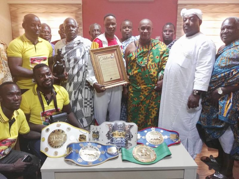 Alhassan Okine pose for the cameras with his laurels