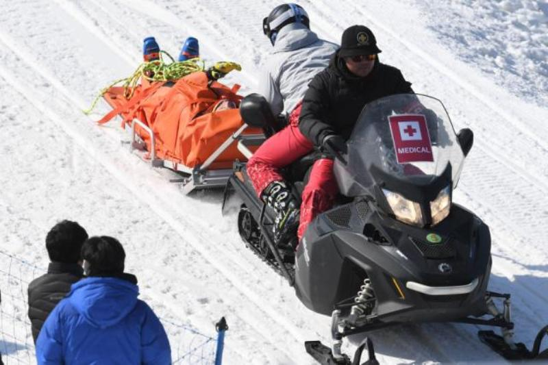 Christopher Del Bosco is transported off the hill