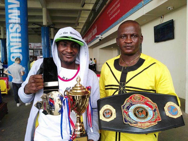 Ghanaian kickboxer Gerald Dah and Nii Dzata I [President of the Ghana Kickboxing Association]