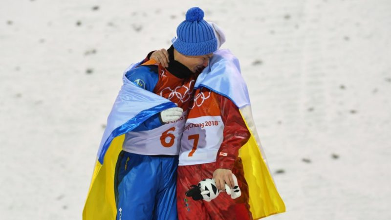 Oleksandr Abramenko of Ukraine and Olympic Athlete of Russia Ilia Burov react during the victory ceremony