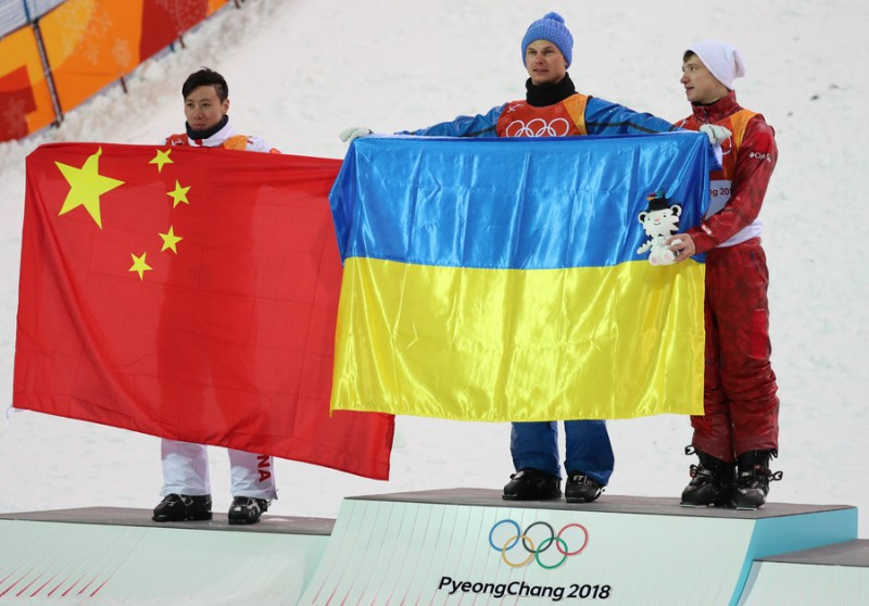 Oleksandr Abramenko of Ukraine and Olympic Athlete of Russia Ilia Burov share pedestal at the victory ceremony