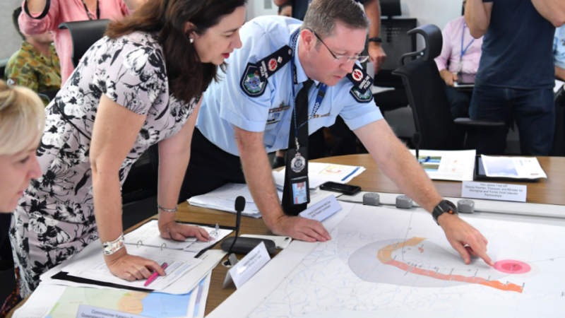 Premier Annastacia Palaszczuk getting a briefing from Police Deputy Commissioner Bob Gee