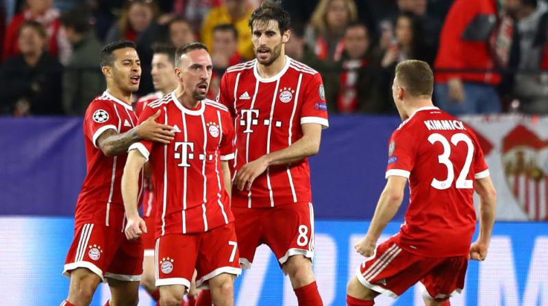 Franck Ribery of Bayern Muenchen celebrates with his team mates after scoring his sides first goal