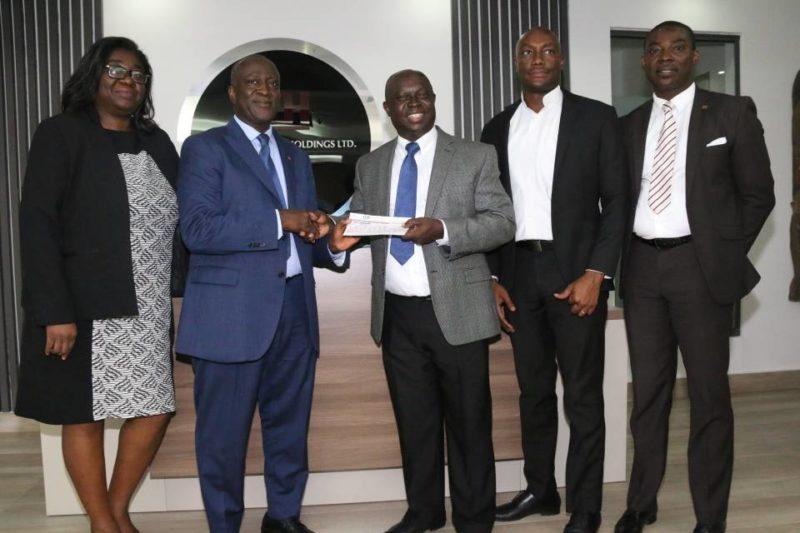 Mr. Kwabena Yeboah [middle] receiving a cheque from CDH Financial Holdings