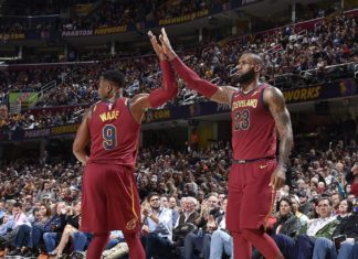 Dwyane Wade #9 of the Cleveland Cavaliers and LeBron James #23 of the Cleveland Cavaliers high five