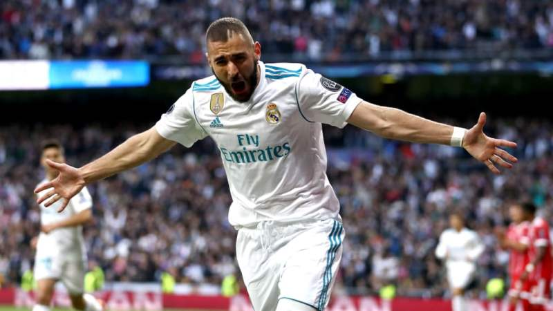 Karim Benzema of Real Madrid celebrates as he scores his sides first goal during the UEFA Champions League Semi Final Second Leg match between Real Madrid and Bayern Muenchen