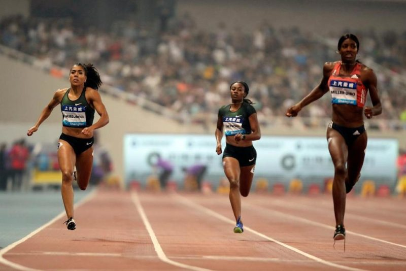 Mujinga Kambundji of Switzerland, left, Kyra Jefferson of the United States, center, and Shaunae Miller-Uibo of the Bahamas, right, compete during the women's 200 meters at the Shanghai Diamond League