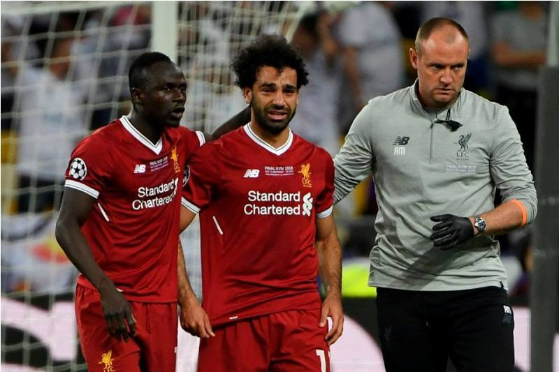 Sadio Mane [left] consoling the injured Mo Salah