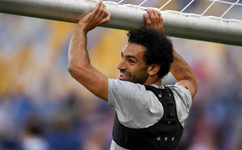 Salah hangs unto the bar