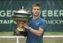 Borna Coric pose for the cameras after beaten Roger Federer to the title