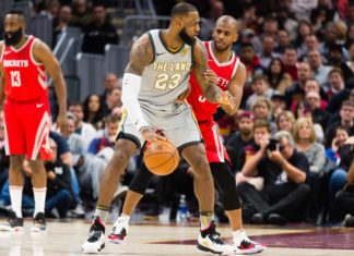 LeBron James #23 of the Cleveland Cavaliers tries to drive around Chris Paul #3 of the Houston Rockets