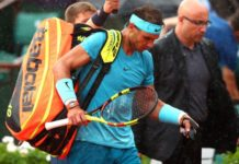 Rafael Nadal leaves the Court Philippe Chatrier following yet another rain interruption