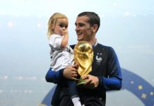Antoine Griezmann of France celebrates victory with daughter Mia