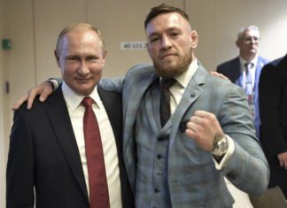 Conor McGregor pose for picture with Vladimir Putin