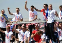 Croatian national football team members ride an open-roof coach in Zagreb International Airport