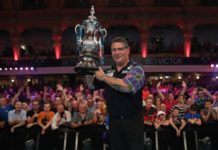 Gary Anderson lifts the Phil Taylor Trophy aloft