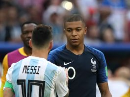 Kylian Mbappe of France consoles Lionel Messi of Argentina