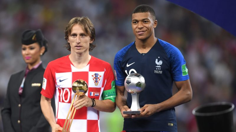 Luka Modric of Croatia receives the Golden Ball award alongside Kylian Mbappe [Young Best Player]
