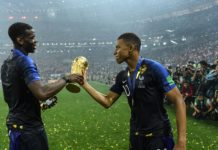 Paul Pogba (L) and Kylian Mbappe of France celebrate victory with the World Cup Trophy