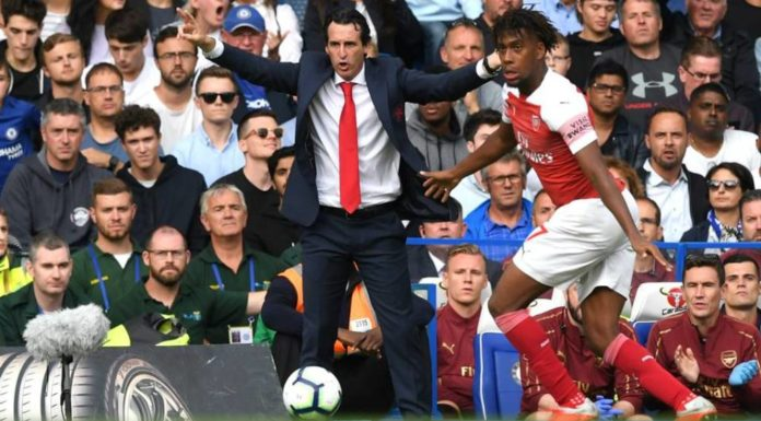 Alex Iwobi controls the ball as Unai Emery issues intruction from the touchline