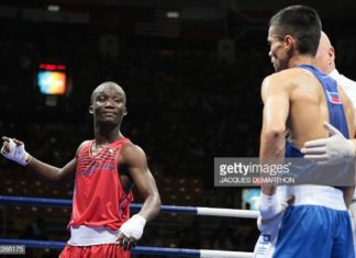 Ghana's Manyo Plange is declared winner after defeating Philippines's Harry Tanamor