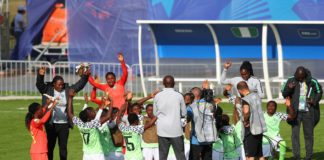 Nigeria team say a prayer after drawing with China