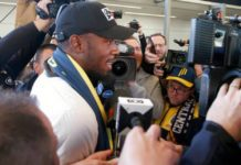 Usain Bolt briefly speaks as he arrives in Sydney, Australia
