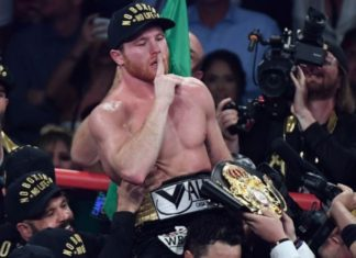 Canelo Alvarez celebrates after his majority decision win over Gennady Golovkin