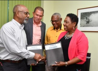 Jamaica's Sports Minister Olivia Grange and sculptor Basil Watson